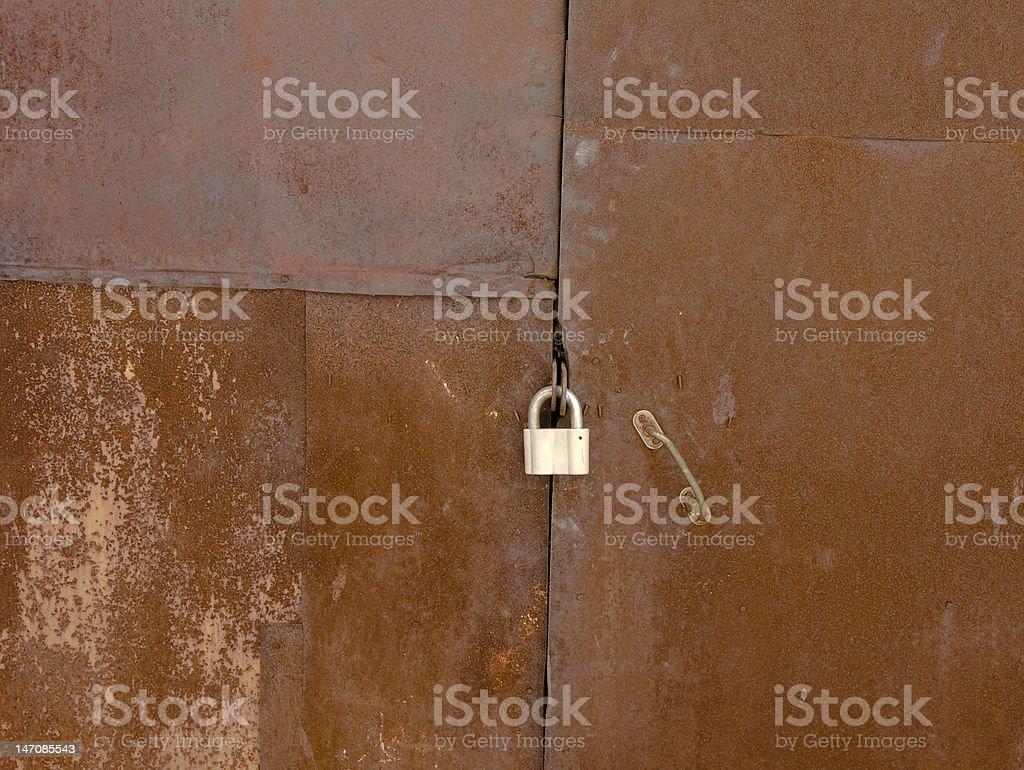 Garage gates with a padlock royalty-free stock photo