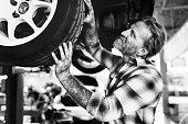 istock Garage Motor Maintenance Mechanic Fixing Spare Concept 656936202