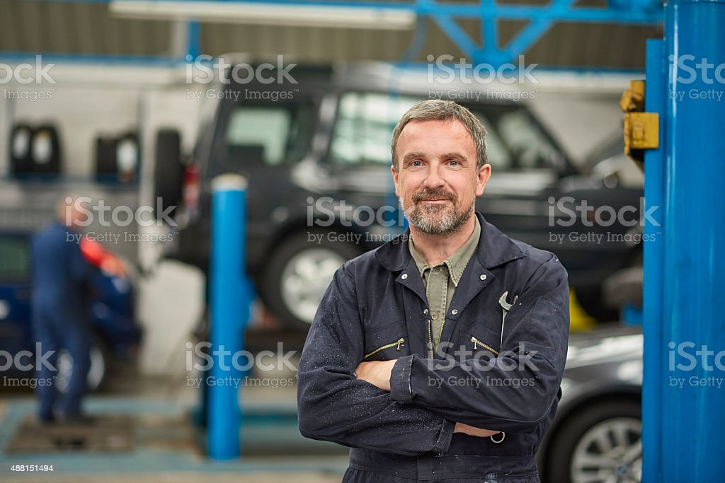 garage owner stock photo