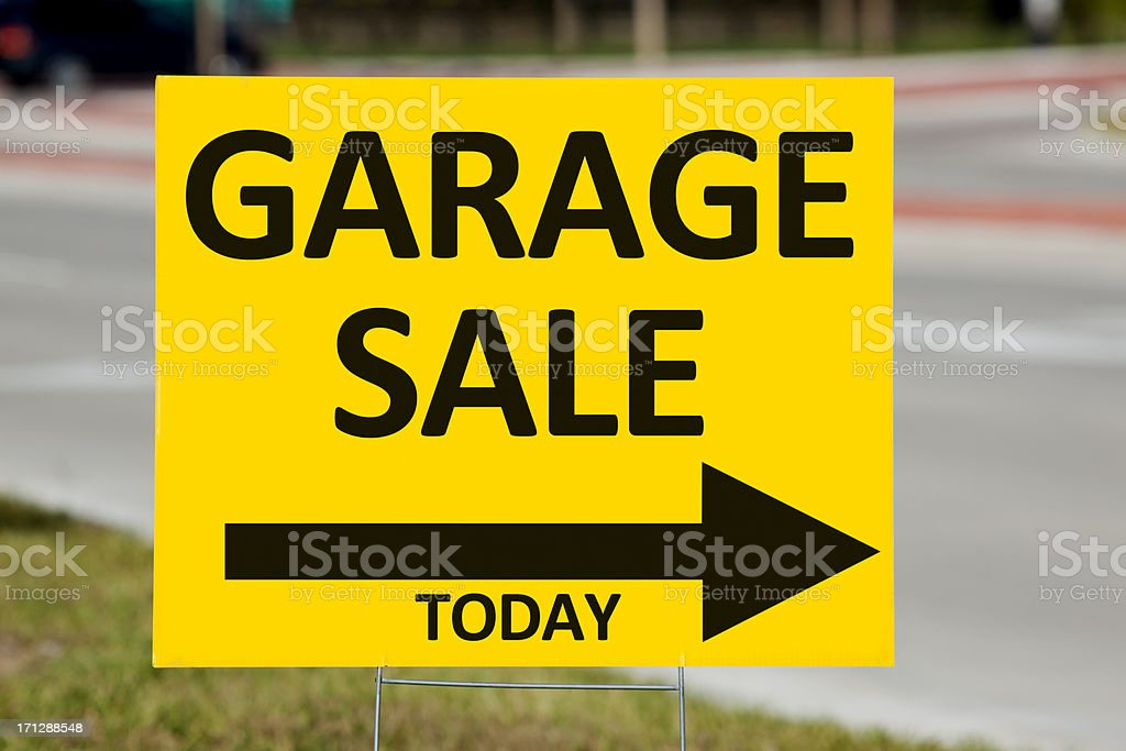 \'Garage Sale Sign By Roadside. In tough economic times, many people...