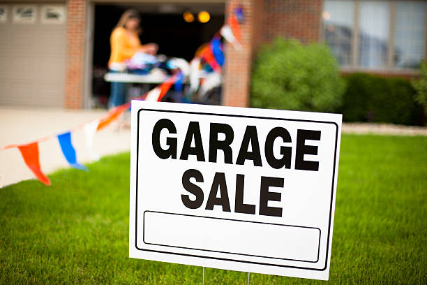 Garage Sale Sign with Woman Shopping stock photo