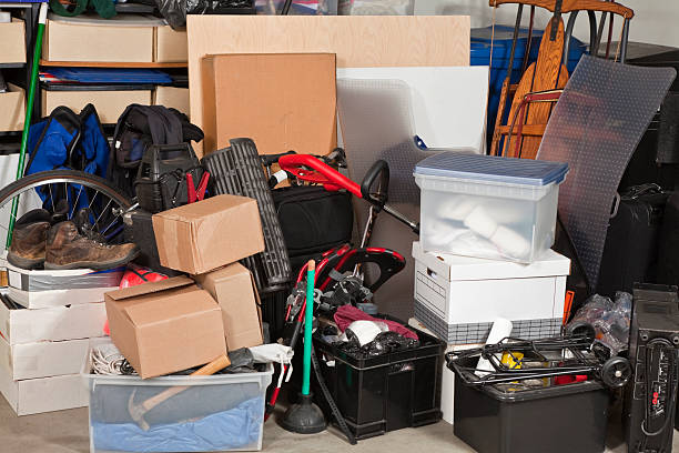 Garage Storage Pile of boxes junk inside a residential garage. arrangement stock pictures, royalty-free photos & images