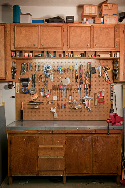 Garage Work Bench Vertical photograph of my garage work bench by special request.  (All visible logos have been removed from tools & packages.)I also have a horizontal version of this photo: workbench stock pictures, royalty-free photos & images