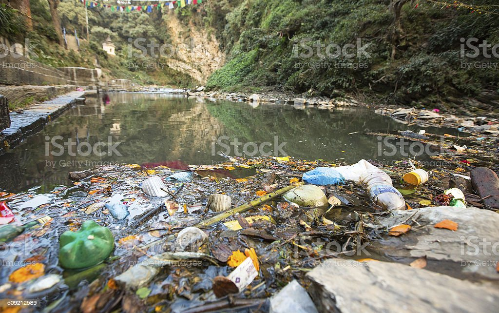Garbage and bottles floating on water stock photo