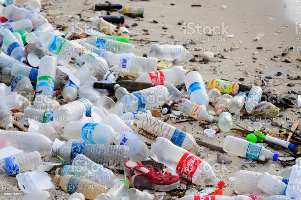 Garbage and plastic bottles on a beach royalty-free stock photo