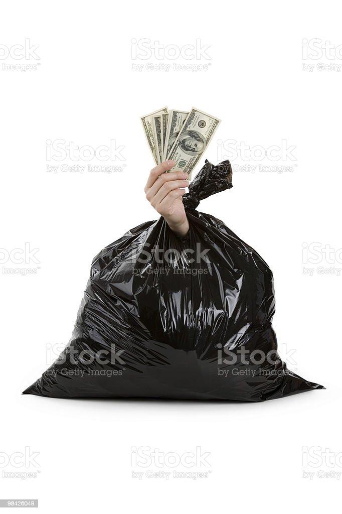 Sacco per immondizia e dollari foto stock royalty-free