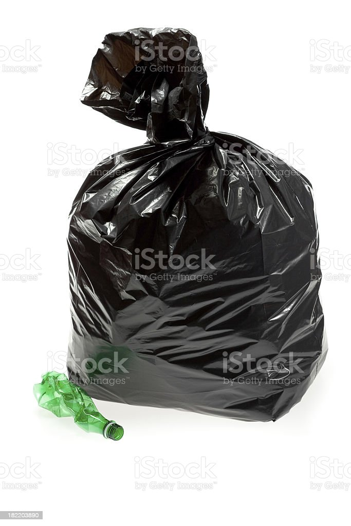 Garbage bag and plastic bottle stock photo