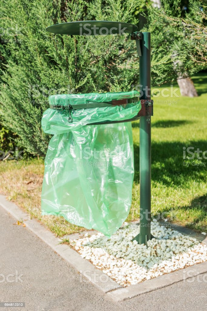 Garbage bag in the park stock photo