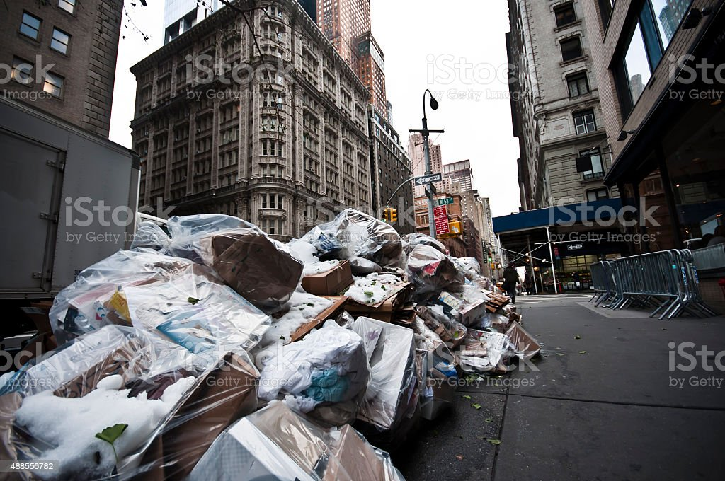 Garbage bags on the sidewalk in New York City, USA stock photo