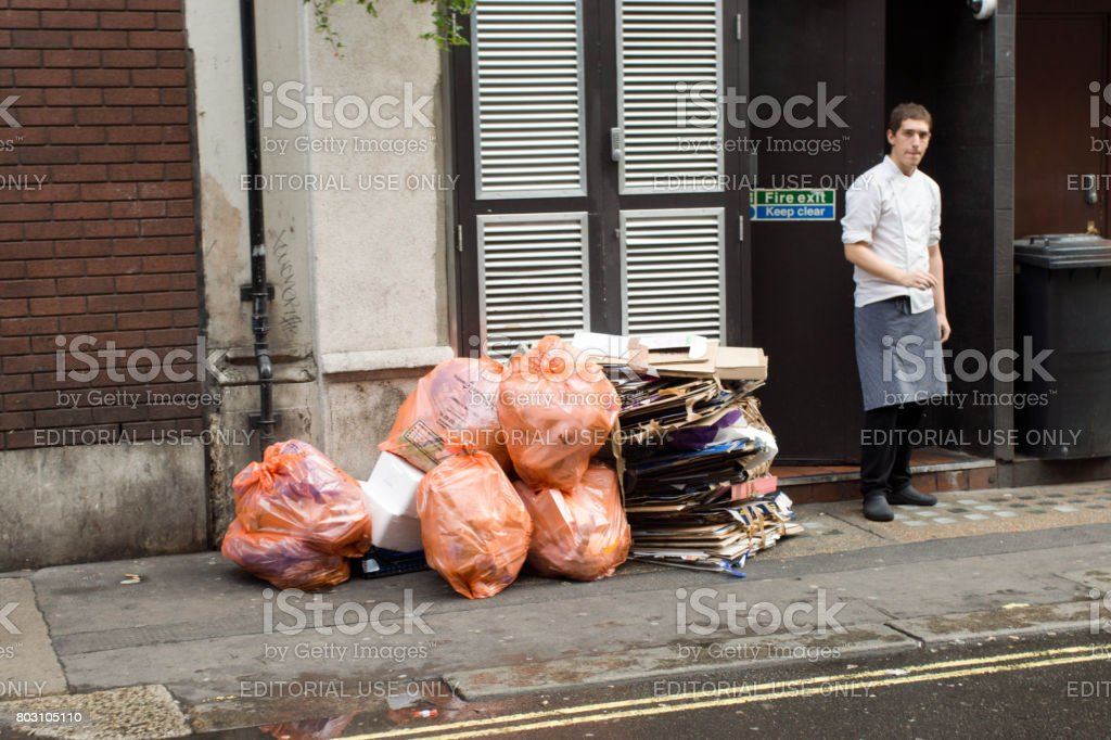 Garbage bags outside a restaurant stock photo