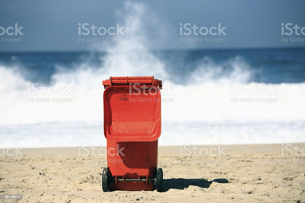 garbage bin container on a beach pollution concept royalty-free stock photo