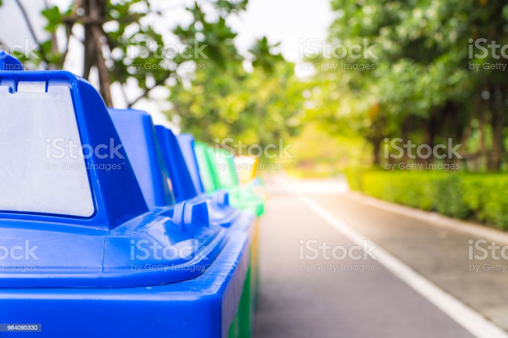 Garbage bin in the park beside the walk way There are 3 types. 3 colors. - Royalty-free Blue Stock Photo