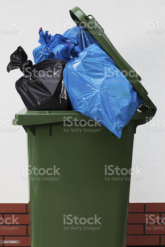 Garbage can over a white background royalty-free stock photo