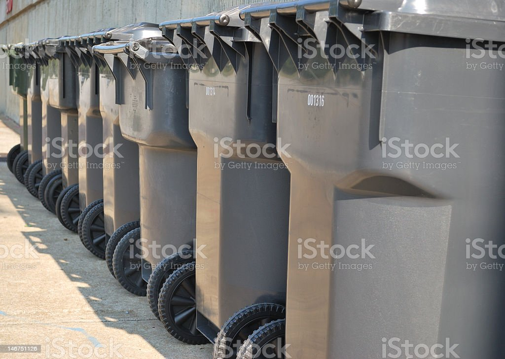 Garbage Cans waiting for pickup stock photo
