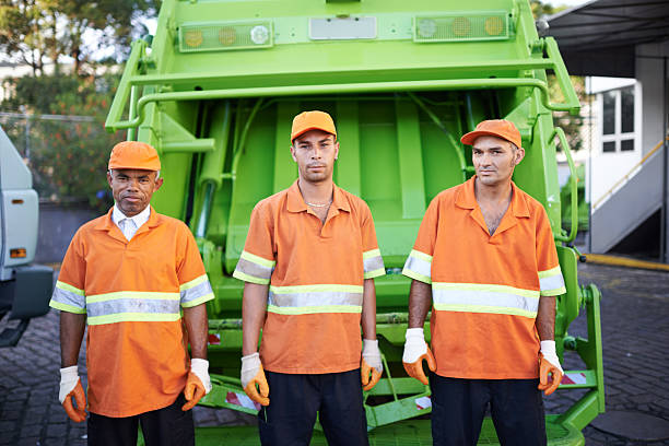 Garbage collection- the men who make it happen Cropped portrait of a garbage collection team street sweeper stock pictures, royalty-free photos & images