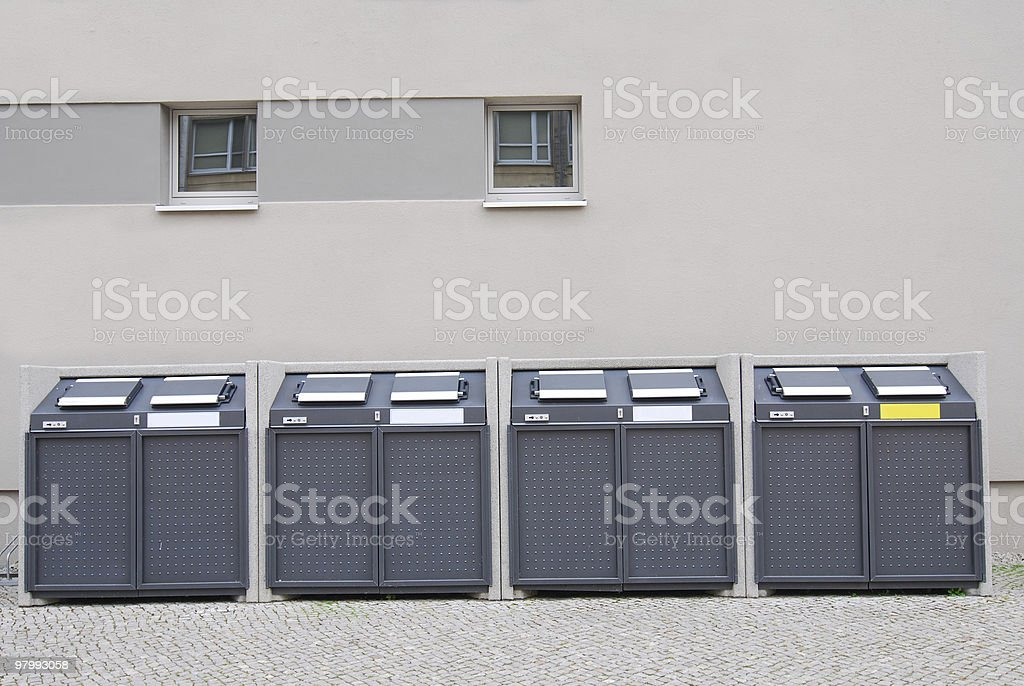 garbage containers in front of the building royalty-free stock photo