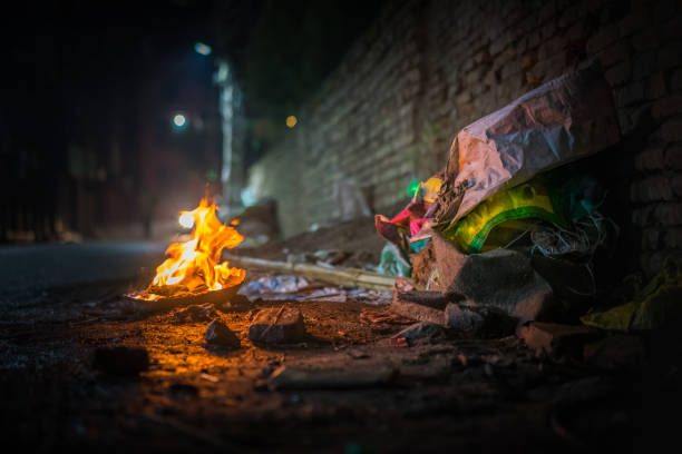 Garbage fire at night Garbage fire at night with burning trash on a dirty street, a metaphor for chaos and current politics riot stock pictures, royalty-free photos & images