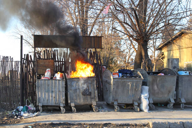 Garbage Fire Dumpster Fire With Heavy Smoke Pollution From Garbage dumpster fire stock pictures, royalty-free photos & images