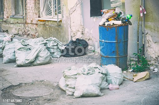 Garbage in bags and barrels on the streets