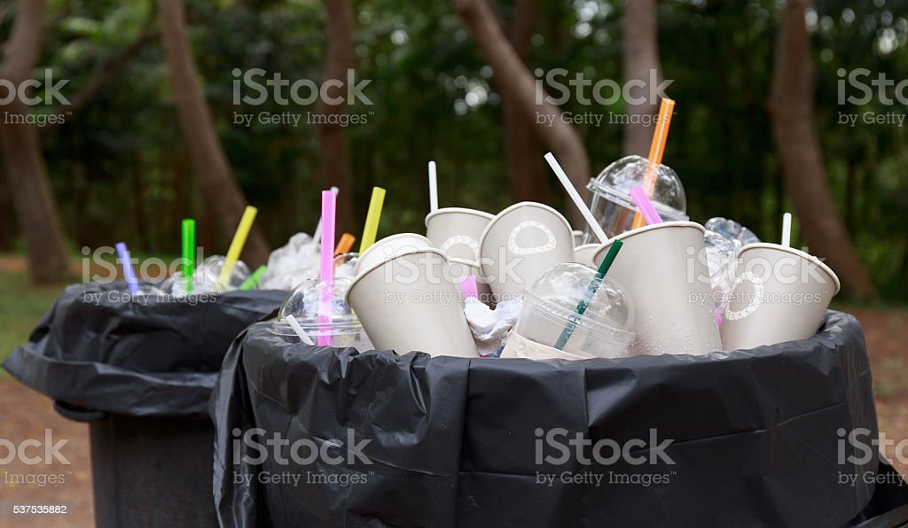 garbage in black bin stock photo
