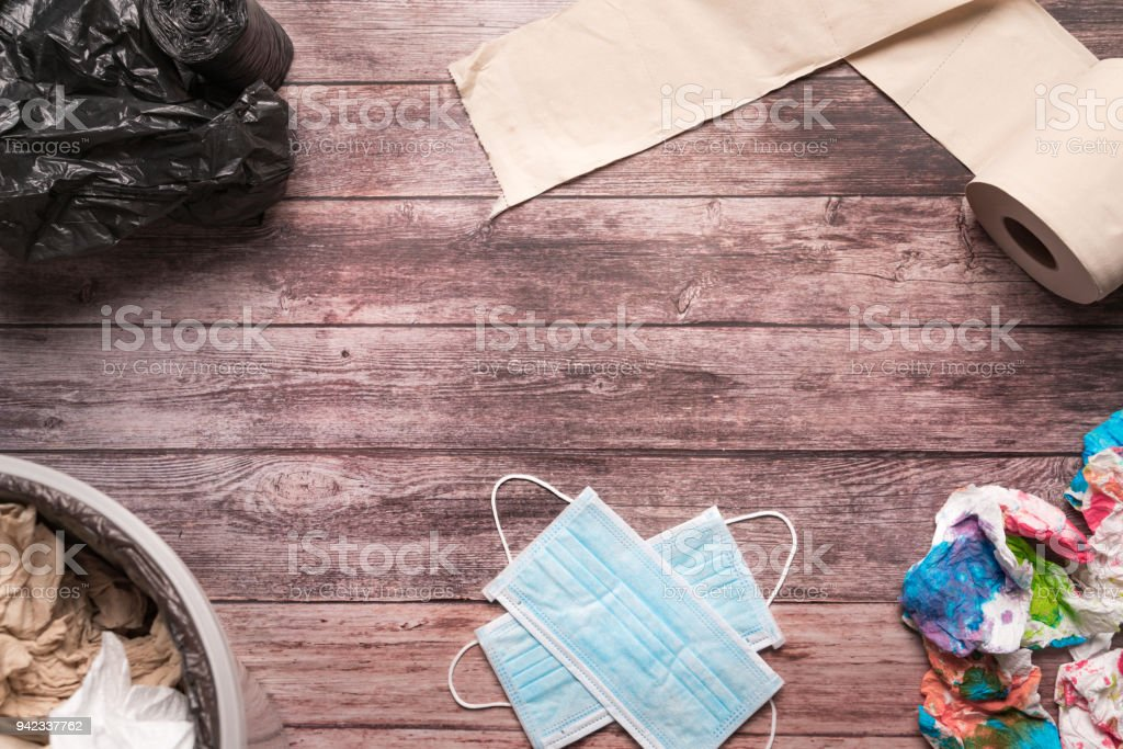 garbage of dirty paper and sanitary hygiene mask on wooden background composition healthcare concept stock photo