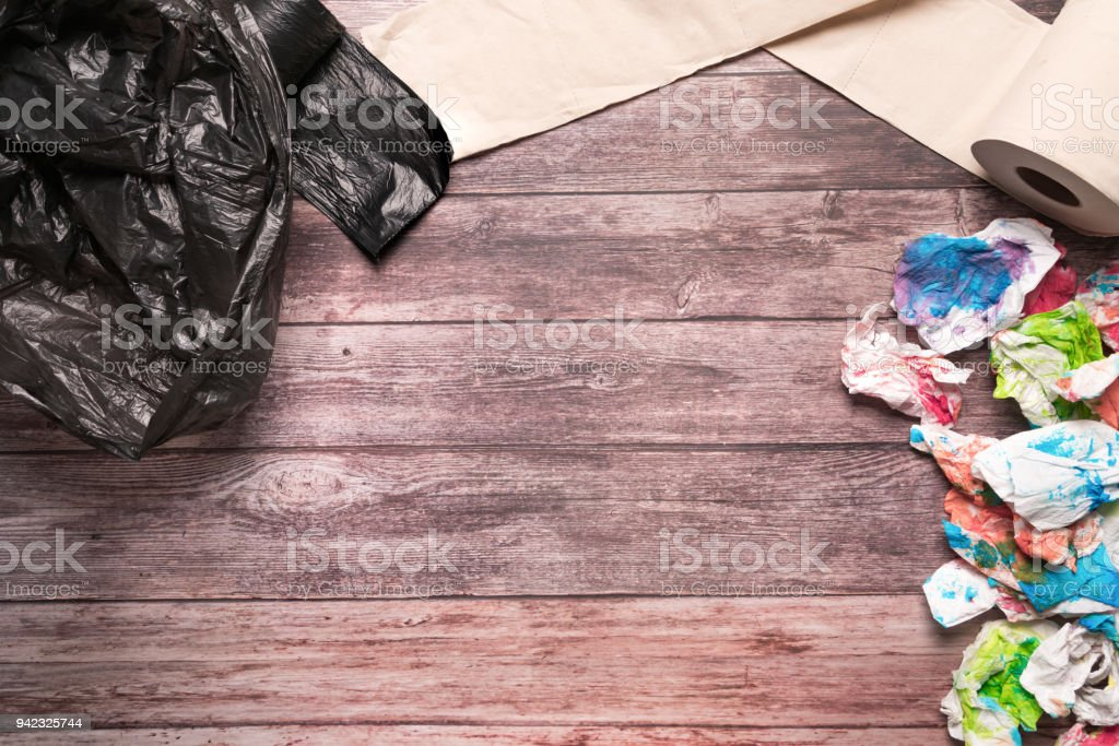 garbage of dirty paper and sanitary hygiene paper on wooden background composition healthcare concept stock photo