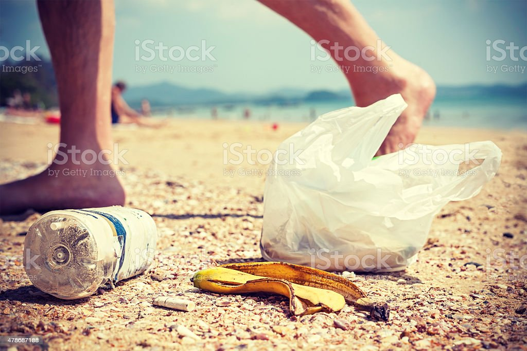 Garbage on a beach left by tourists. stock photo