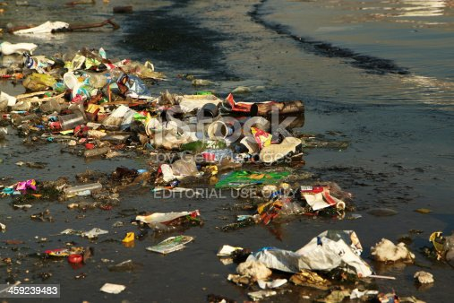 Istanbul, Turkey - November 1, 2012: Lots of garbage made of different material floating on the water at golden horn district of istanbul,Turkey