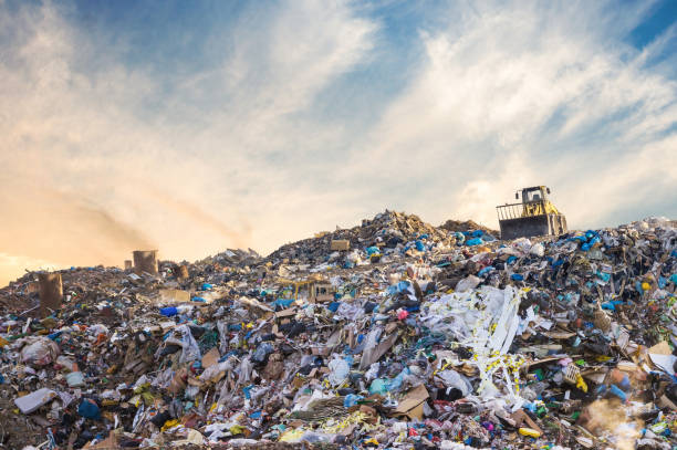 garbage pile in trash dump or landfill. pollution concept. - plastic stock pictures, royalty-free photos & images