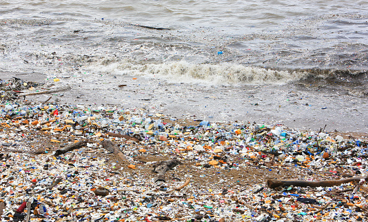 Garbage, plastic bags and bottles covering a city beach of Santo Domingo, the capital of the Dominican Republic.