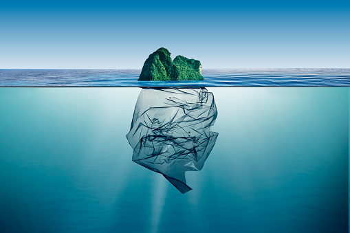 garbage plastic with island floating in the ocean.