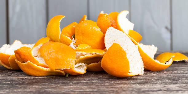 garbage korst mandarijnen - geschild stockfoto's en -beelden