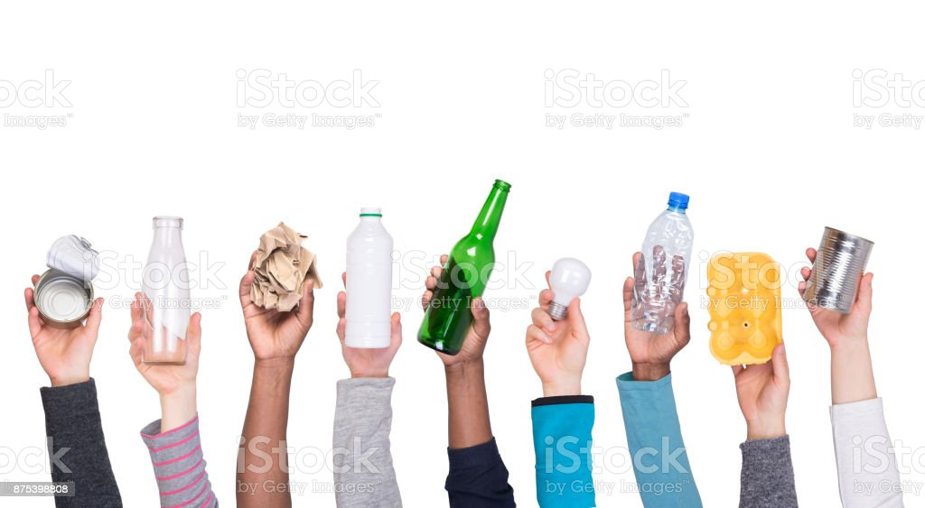Garbage that can be recycled held in hands stock photo