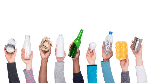 garbage that can be recycled held in hands - glass material stock pictures, royalty-free photos & images