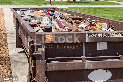 istock Garbage, trash or waste dumpster full of household junk. Concept of cleaning, cleanup, hoarding and disposal. 1225674434