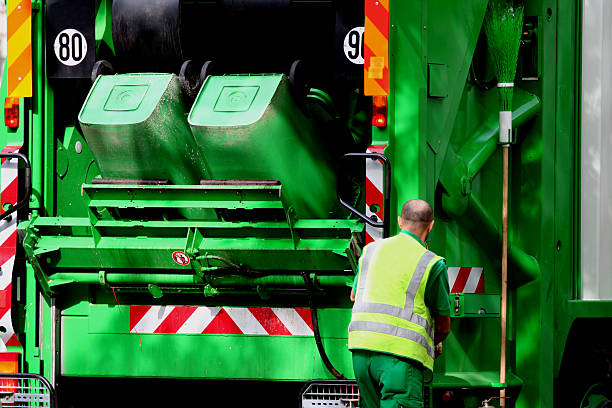 Garbage truck and worker  street sweeper stock pictures, royalty-free photos & images