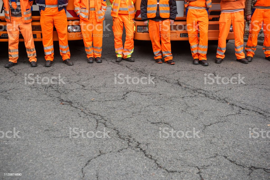 Garbage truck drivers standing in front of their vehicles, Germany - fotografia de stock