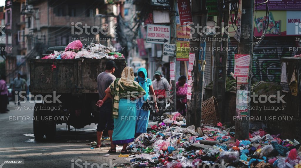 Garbage Truck Drops Trash and Rubbish on Thamel Street stock photo