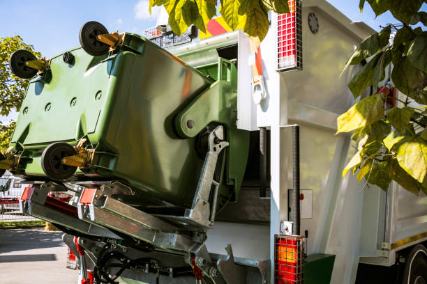 Garbage truck lifting disposal container stock photo