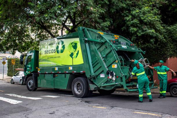 Garbage truck on street of Sao Paulo city, Brazil stock photo