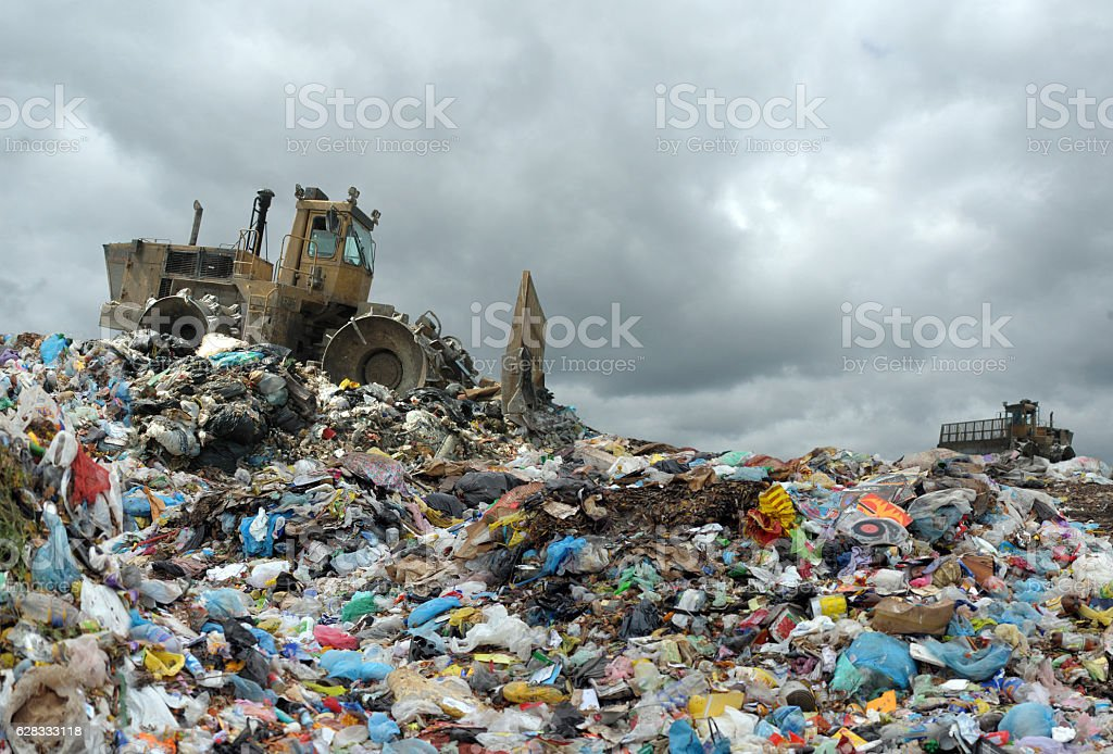 Garbage truck unloading at the dump stock photo