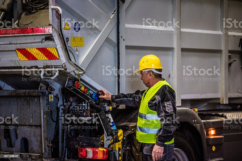Garbage truck with worker stock photo