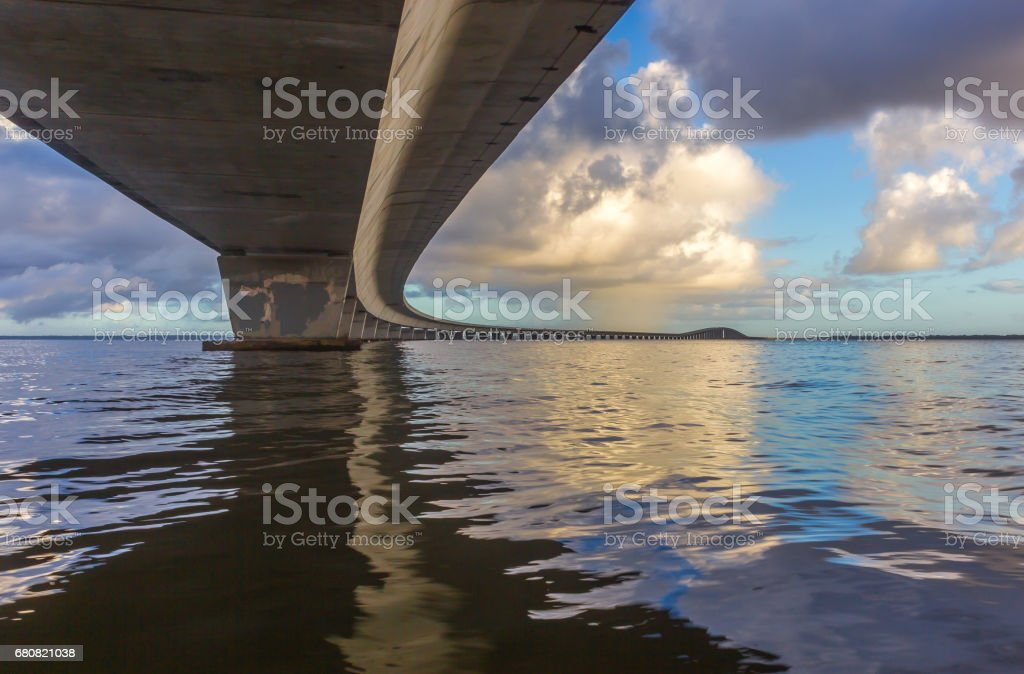 Garcon Point Highway Bridge Over Water at Sunrise stock photo