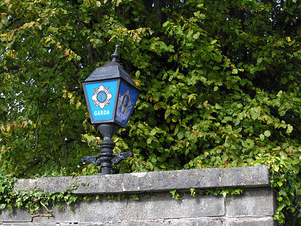 Garda sign outside station in Ennis Co. Clare Ireland Irish police lamp or Garda sign outside the station in Ennis Co. Clare Ireland. county clare stock pictures, royalty-free photos & images