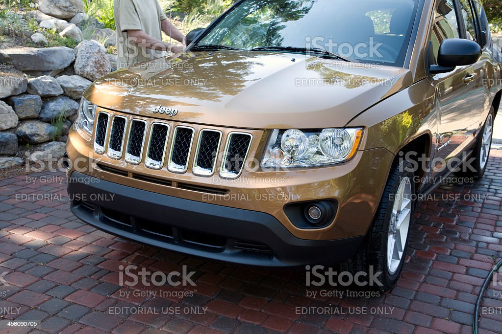 Garden Art Reflected While Washing  The New Jeep Compass royalty-free stock photo
