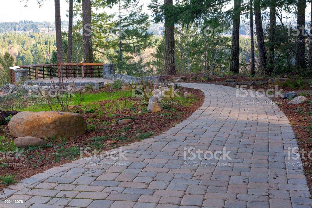Garden Backyard brick stone concrete pavers walking path hardscape stock photo