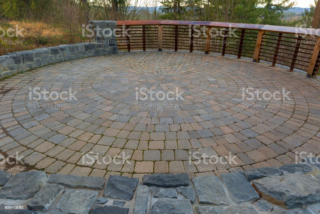 Garden Backyard Circular Brick Stone Pavers Hardscape Patio With Wood  Railings Stone Wall Landscaping Royalty