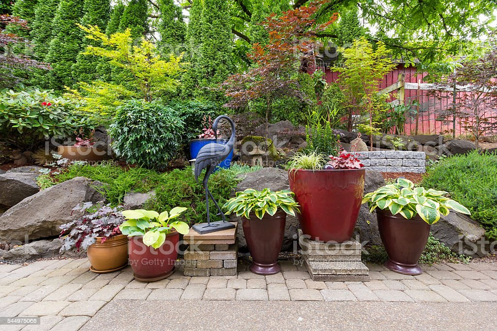 Garden Backyard Landscaping with Plants and Stone Pavers stock photo