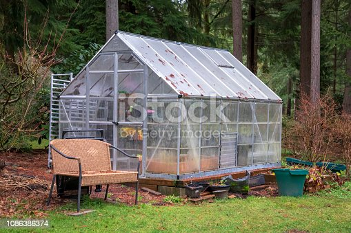 Garden bench and greenhouse not in use during the winter months