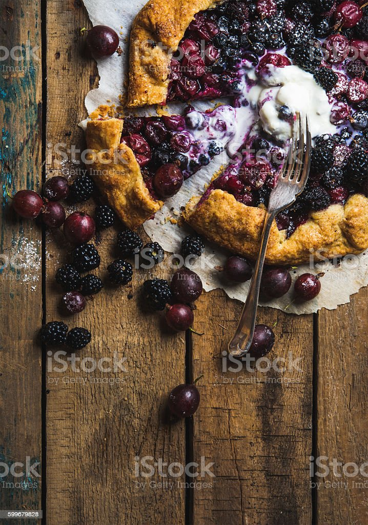 Garden berry galetta sweet pie with melted vanilla ice-cream stock photo